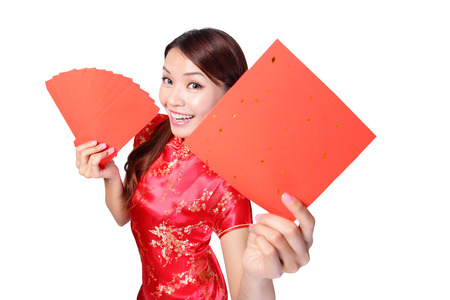 Happy young asian woman holding blank red couplets for celebrating chinese new year photo