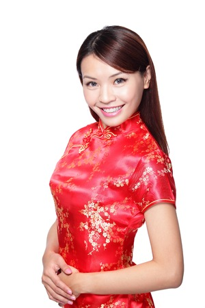 happy Chinese new year. smile young Asian woman dress traditional cheongsam  photo