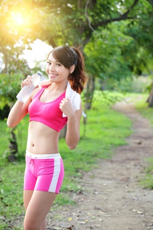 asian sport: Healthy woman drinks water, doing sport outdoor, fitness, diet & body care concept Stock Photo