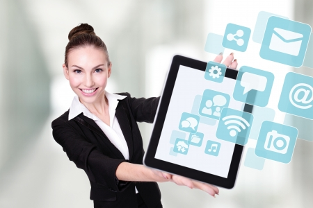Business Woman or teacher showing tablet pc computer with Social media icon photo