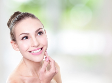 attractive smiling woman face with health teeth close up , copy space on the right side  Isolated over green