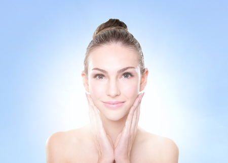 the caucasian beauty: Close up portrait of beautiful young woman face. Isolated on blue background. Skin care or spa concept