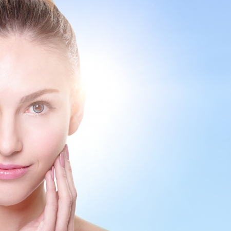 clear skin: portrait of the woman with beauty face and perfect skin isolated on blue background