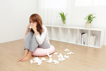 human nose: Sick Woman sneezing into Tissue. Flu and Woman Caught Cold.