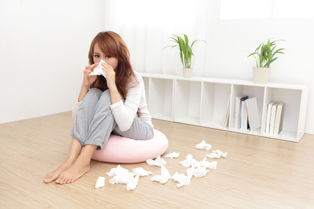 Sick Woman sneezing into Tissue. Flu and Woman Caught Cold. Stock Photo - 25306386