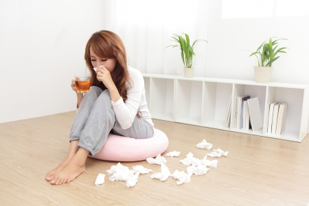 Sick Woman sneezing into Tissue. Woman Caught Cold. photo