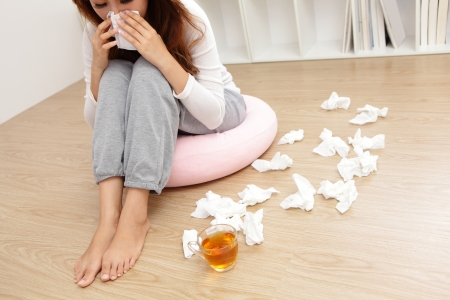 Sick Woman sneezing into Tissue. Woman Caught Cold. Stock Photo - 25306387