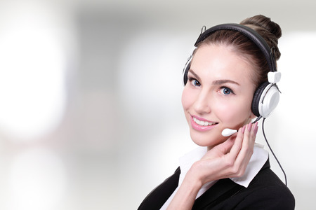 Business Woman customer service worker, call center smiling operator with phone headset   photo