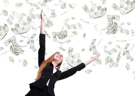 sotto la pioggia: Business donna eccitato felice guardare avanti sotto una pioggia di soldi - isolato su uno sfondo bianco