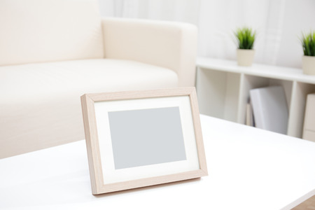 old home office: blank photo frame with copy space on white table at home
