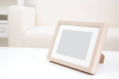 blank photo frame with copy space on white table at home photo