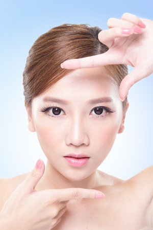 Beautiful Woman face and she making frame with hands, concept for skin care , asian photo