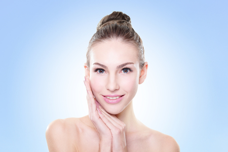 the caucasian beauty: Close up portrait of beautiful young woman face. Isolated on blue. Skin care or spa concept