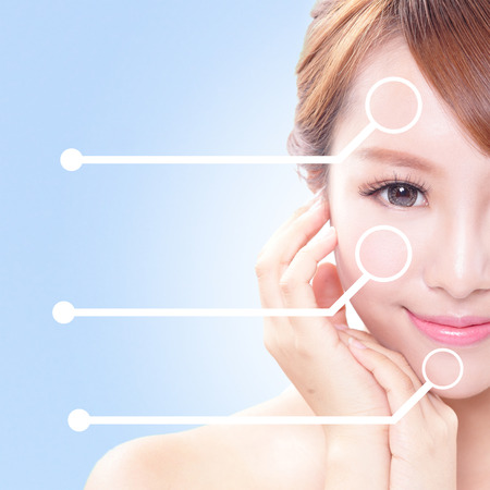 half body: portrait of the woman with beauty face and perfect skin isolated on blue, asian beauty Stock Photo