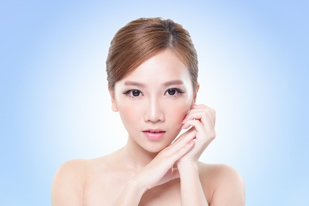 close up of attractive woman face with blue, asian beauty photo