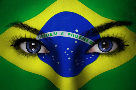 Woman with Brazil flag painted on her face photo
