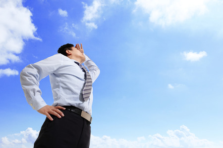 vision business: Successful business man purposefully looking away with blue sky, asian male