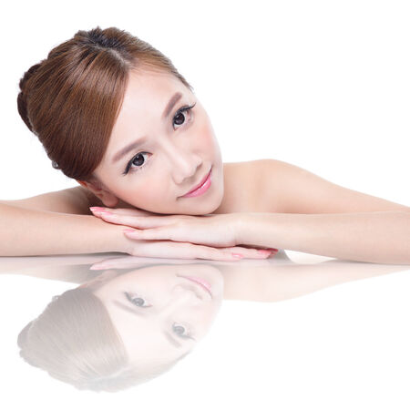 mirror face: Beautiful face skincare beauty woman lying down with mirror reflection isolated on white background. asian