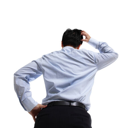 low back: Back pose of business person thinking, low angle view. Isolated on white background