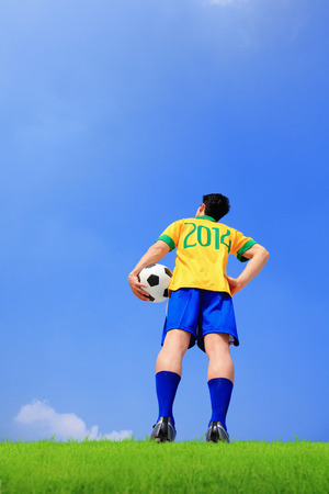 Brazilian football player with 2014 shirt look blue sky on field photo