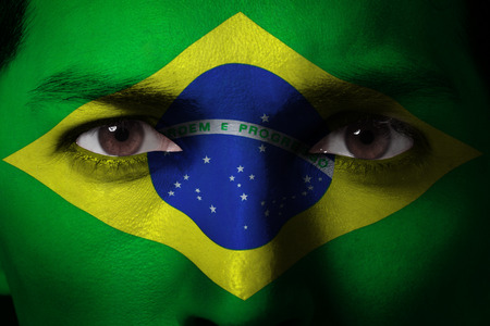 Portrait of a man with a painted flag of Brazil - Latin America Stock Photo - 26143578