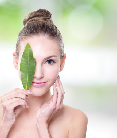 skin care woman: Skin care woman face with green leaf, concept for skin care or organic cosmetics