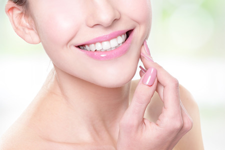 attractive smiling woman face with health teeth close up, dental care concept