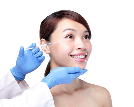 injection woman: Close up of cosmetic injection to the pretty woman face. Isolated on white background, asian Stock Photo