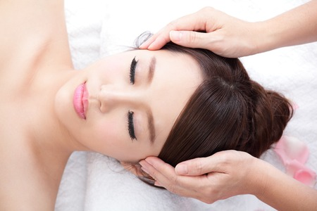 asian woman face: Beautiful young woman enjoy face massage at spa with roses, asian beauty Stock Photo