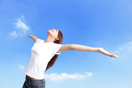 Happiness freedom concept. Woman happy smiling with arms up, asian beauty photo