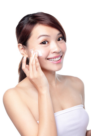 moisturize: Portrait of beautiful young girl with clean skin on pretty face Stock Photo