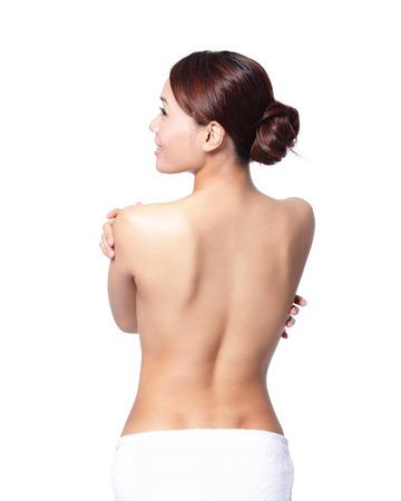 femme se deshabille: belle femme vue de dos, isol� sur fond blanc, asiatique Banque d'images