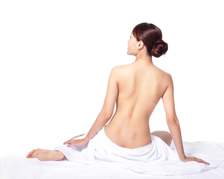 sexy topless women: woman back view and wearing towel sitting on the floor, isolated on white, asian