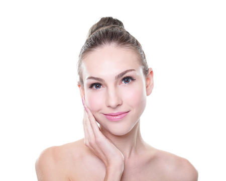 skin care woman: Beautiful young Skin care woman face. Isolated on white background. Skin care or spa concept