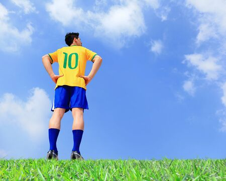 Brasil soccer player man at the stadium with blue sky photo
