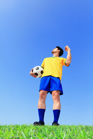 Brazil soccer player man with ball at the stadium with blue sky photo