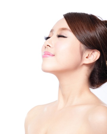 close up of attractive woman face relax closed eyes with blue background, asian beauty photo