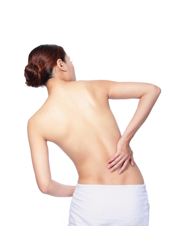 woman is having a pain in her back and waist isolated on white, asian Stock Photo