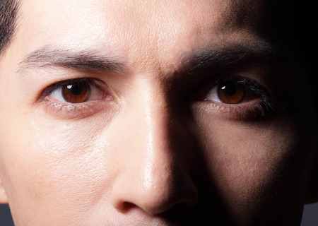 eye shadows: Close up of eyes from a young man, asian Stock Photo