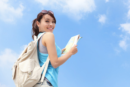 traveller: Happy travel woman look map and look to you with sky background, asian