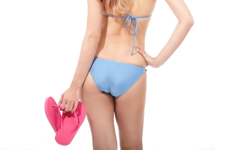 Girl in blue bikini swimsuit isolated on white background Stock Photo - 27342983