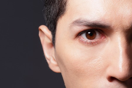 close up eyes: Close up of eyes from a young man, asian Stock Photo