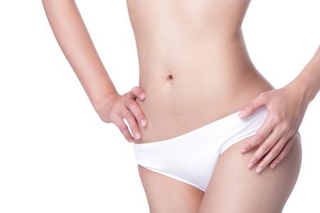 mujeres jovenes desnudas: Hermoso cuerpo de la mujer delgada aislados en fondo blanco Foto de archivo