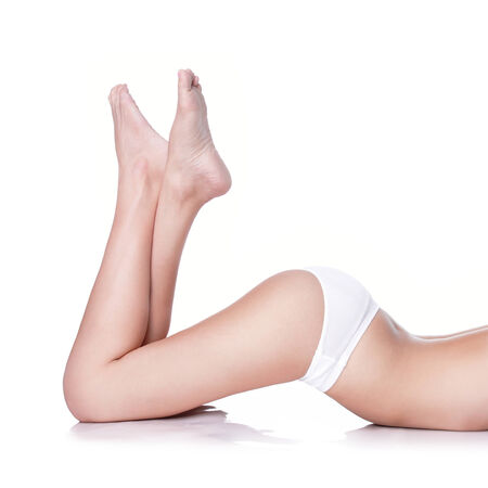 Sexy woman leg and hip with white bikini panties lying on white background, attractive sexy body Stock Photo - 27343022