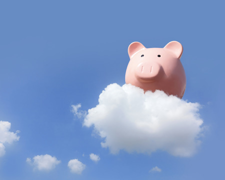 Piggy bank flying free in sky with cloud, concept for business and cloud computing photo