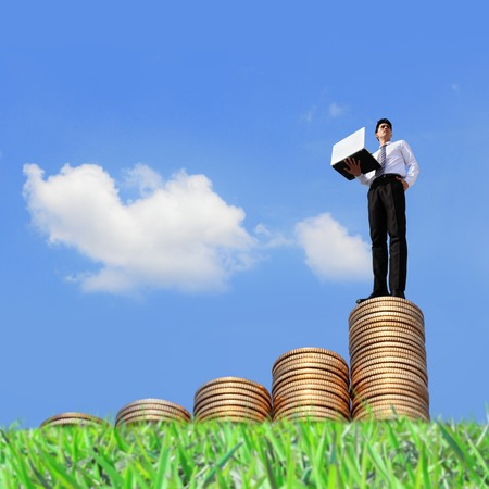 asian coins: Successful business man working on growth money stairs coin with sky