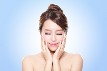 closed: close up of attractive Skin care woman face relax closed eyes with blue background, asian beauty