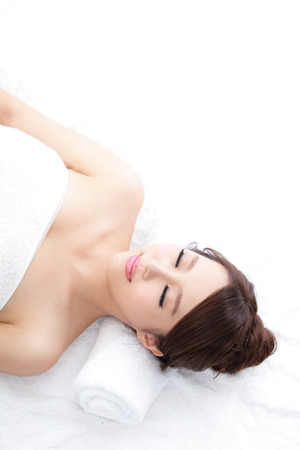 relax massage: Beautiful young woman enjoy massage at spa, she is very relaxed, asian beauty