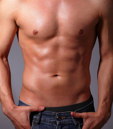 asian abs: Sexy muscular young man. Isolated on gray background. asian and european mixed blood