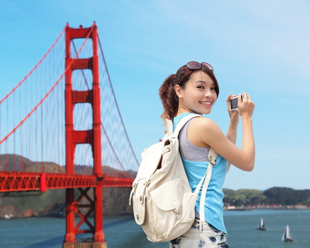 Happy woman travel in San Francisco take photo by camera photo